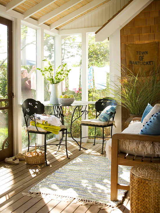 Closed in porch with bistro set