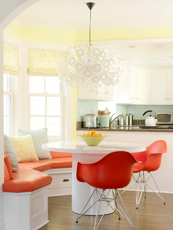 White dining area with orange seating