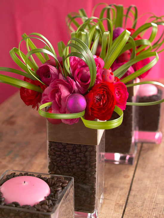 Red and pink flowers in rectangle vase, green leaves