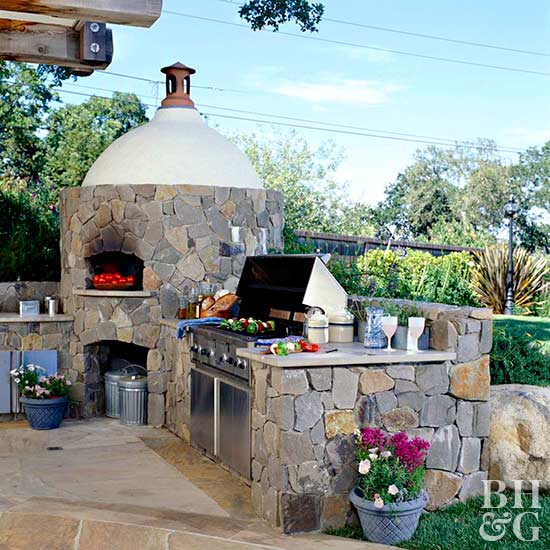 outdoor stone fireplace and dining area
