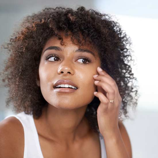 6 Surprising Facts About Dark Spots—and How to Get Rid of Them