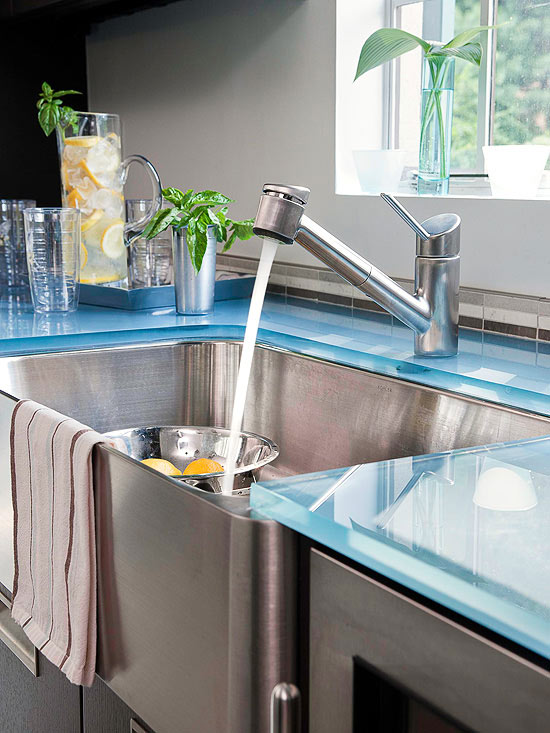 Glass countertop and stainless steel farm sink