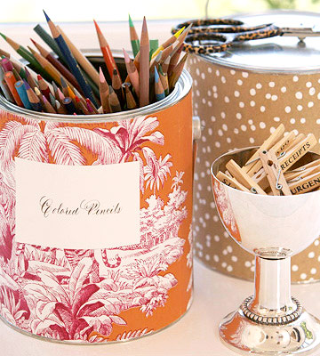 Paint can wrapped in red floral wallpaper holds colored pencils