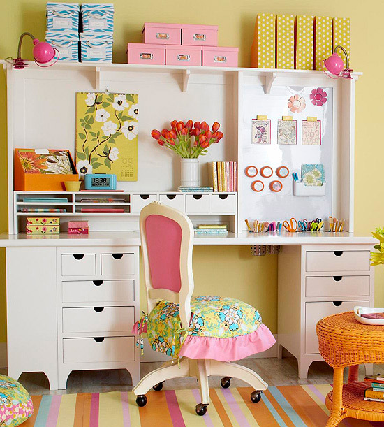 White hutch with finger cubbies, drawers, files, and brightly colored storage boxes
