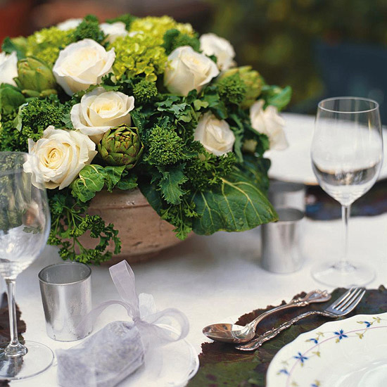 white roses in vase by set table