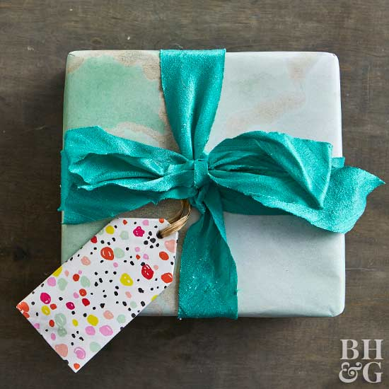turquoise wrapped gift with bow