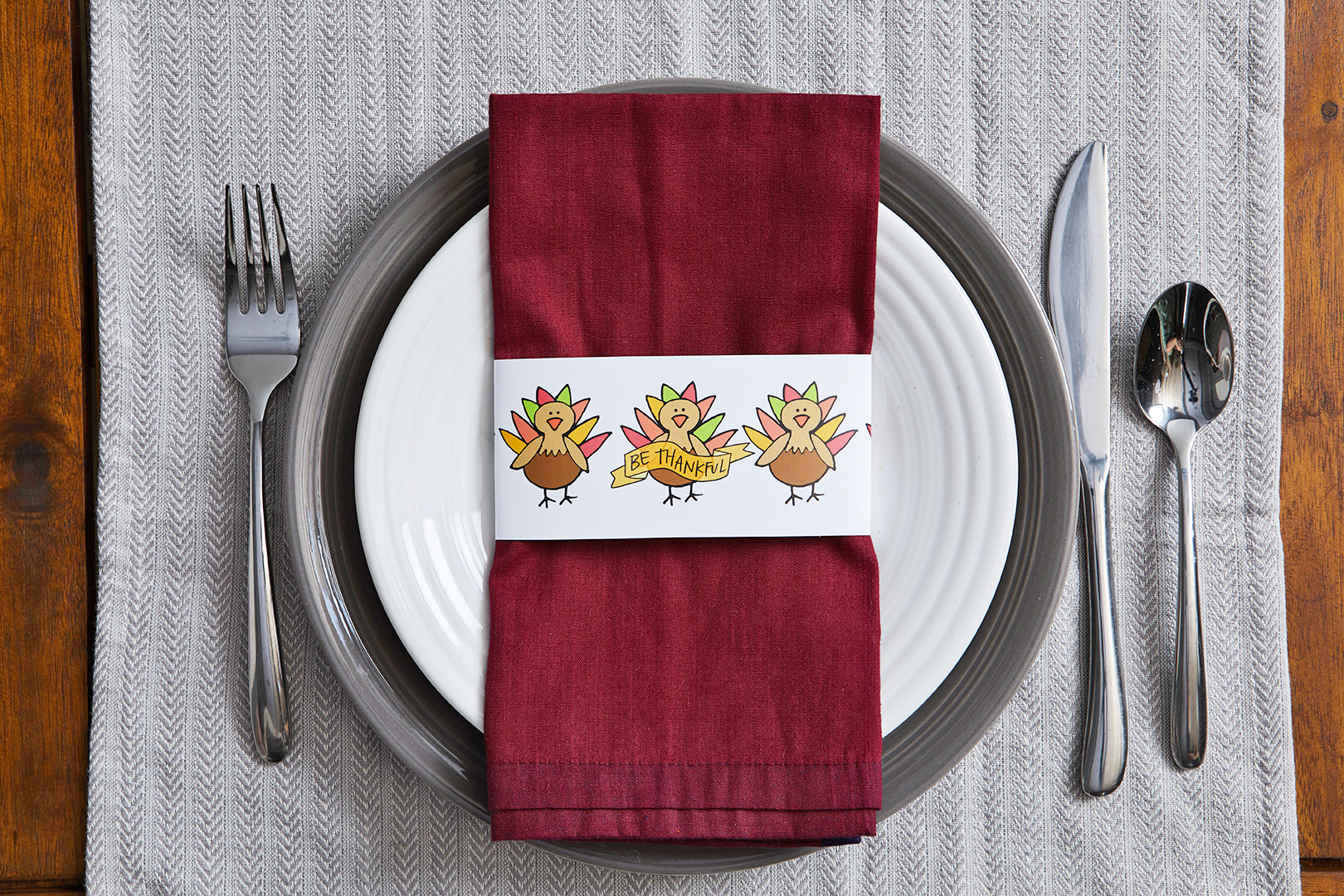 thanksgiving place setting with turkey printed napkin ring