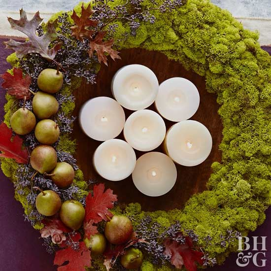 moss wreath with candles in the center