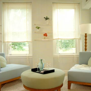 Living Room With White Rollup Fabric Shades