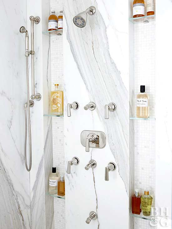 marble shower with built-in glass shelving