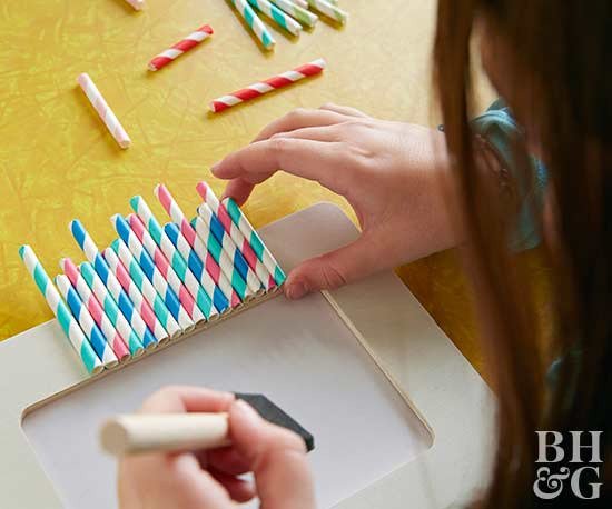 kids party gluing straws to picture frame