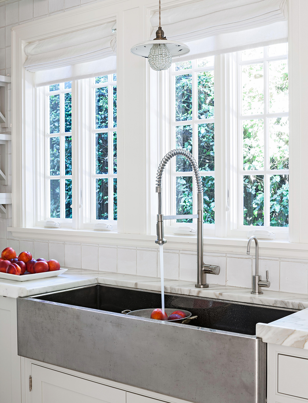 kitchen with large open sink and faucet by windows