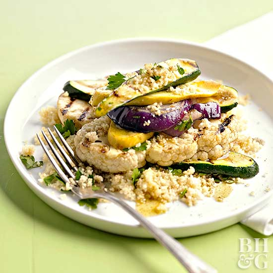 couscous and zucchini and yellow squash on plate