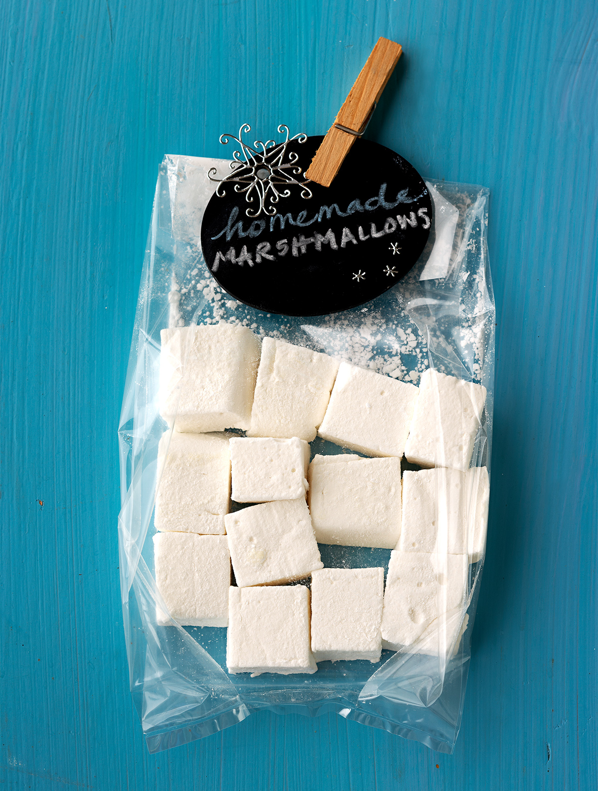 clear package of homemade marshmallows and decorative black tag