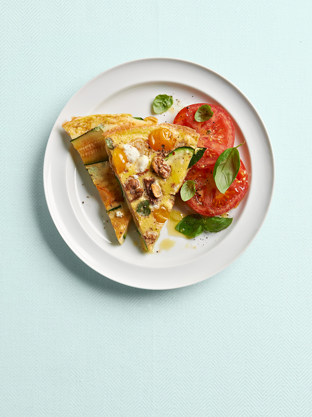 Zucchini and Tomato Frittata on white plate