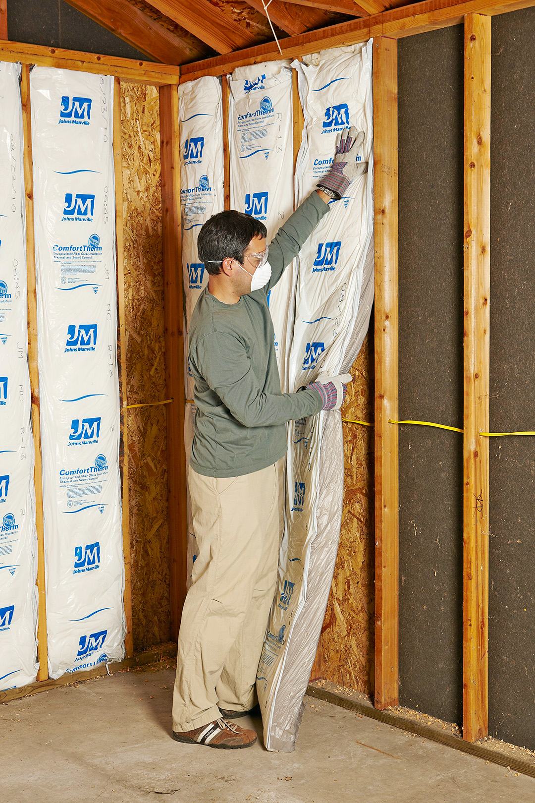 Man Ing Insulation Into Walls