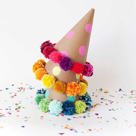 DIY fun and colorful pom pom party hats