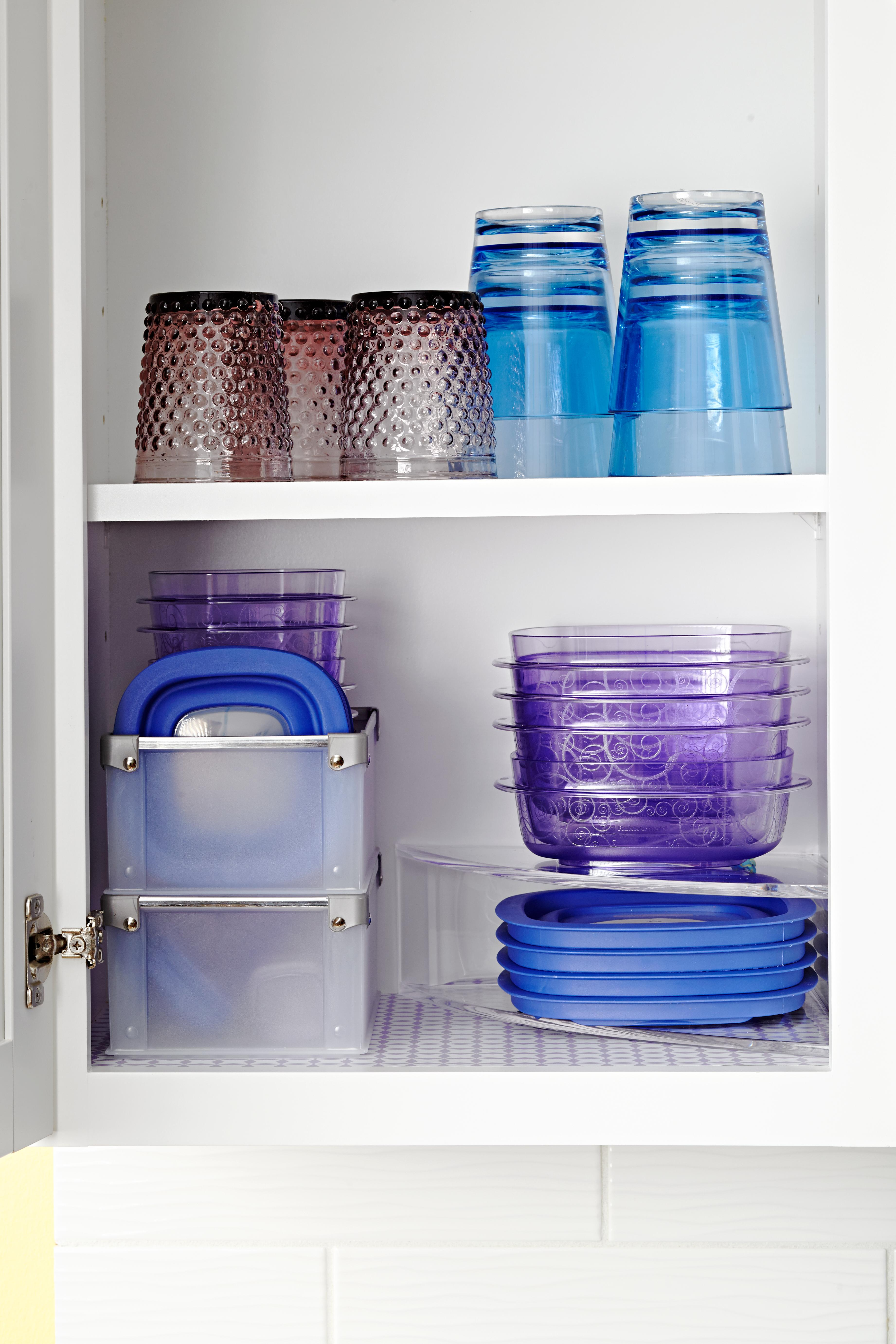 organized cupboard of blue and purple food storage containers