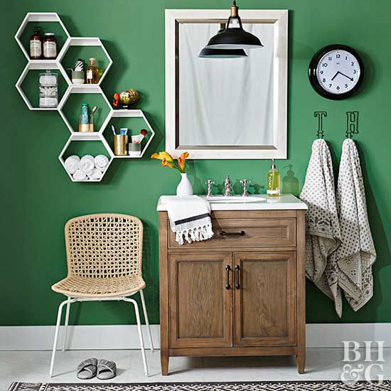 modern green bathroom with black and white accents