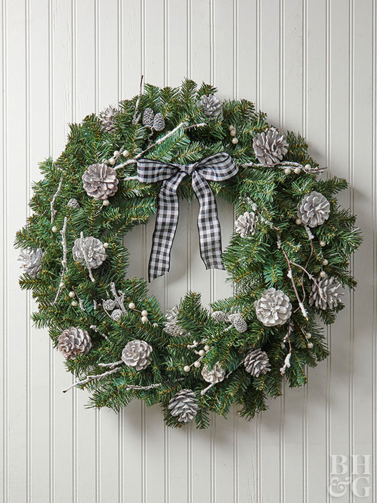 Silver pinecone accented wreath with plaid bow