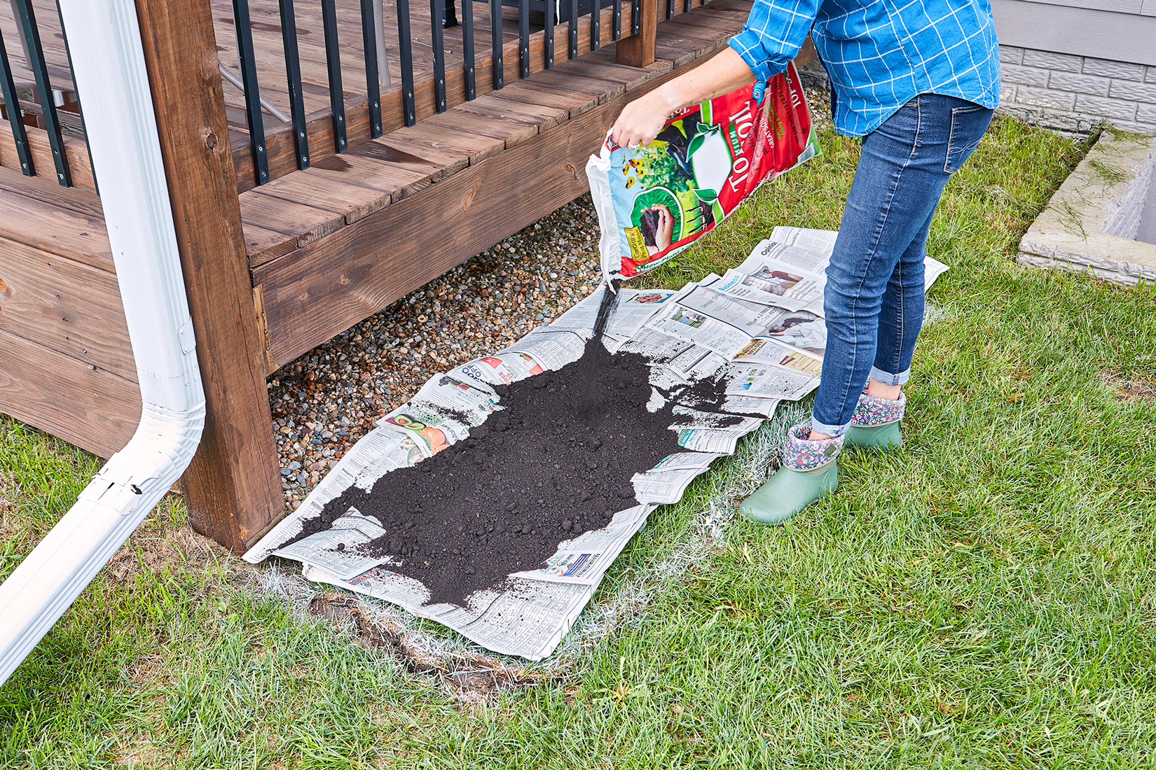 pour layer of topsoil on newspaper