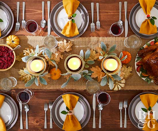 thanksgiving table with candle centerpiece