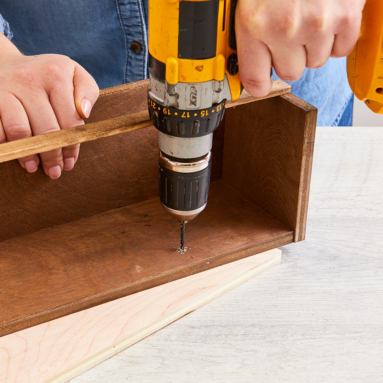 create pilot holes in shelf with drill