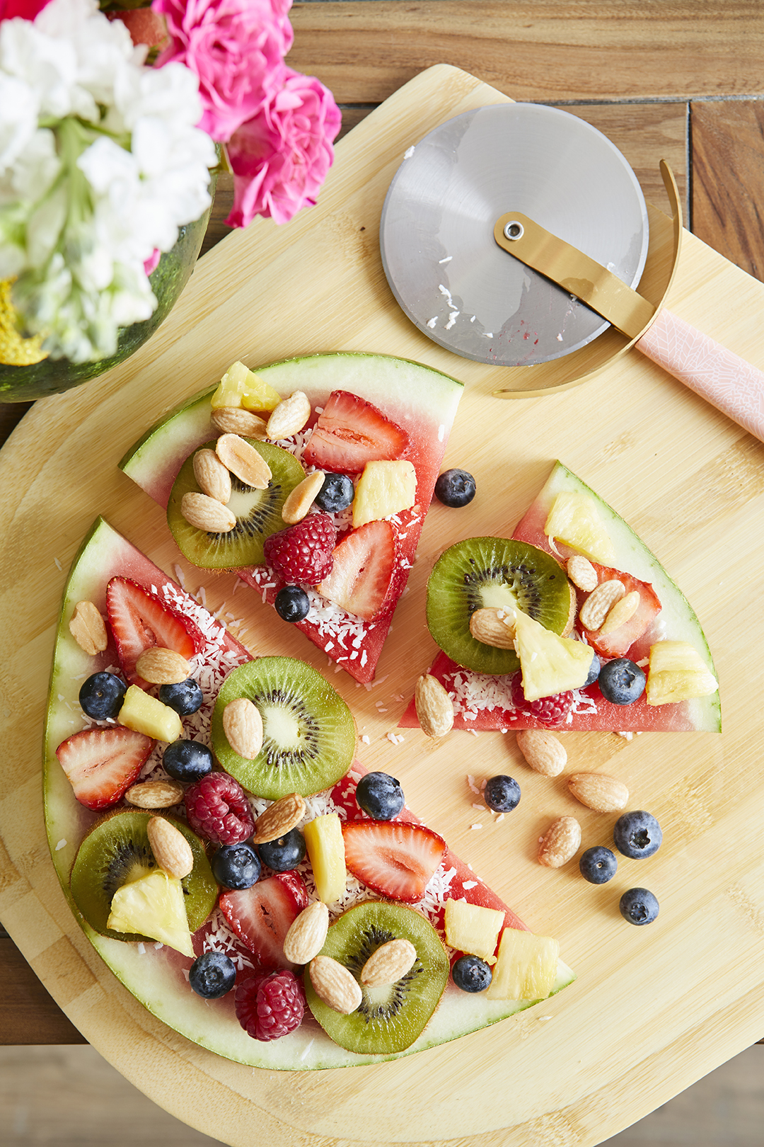 watermelon pizza topped with fruit and nuts