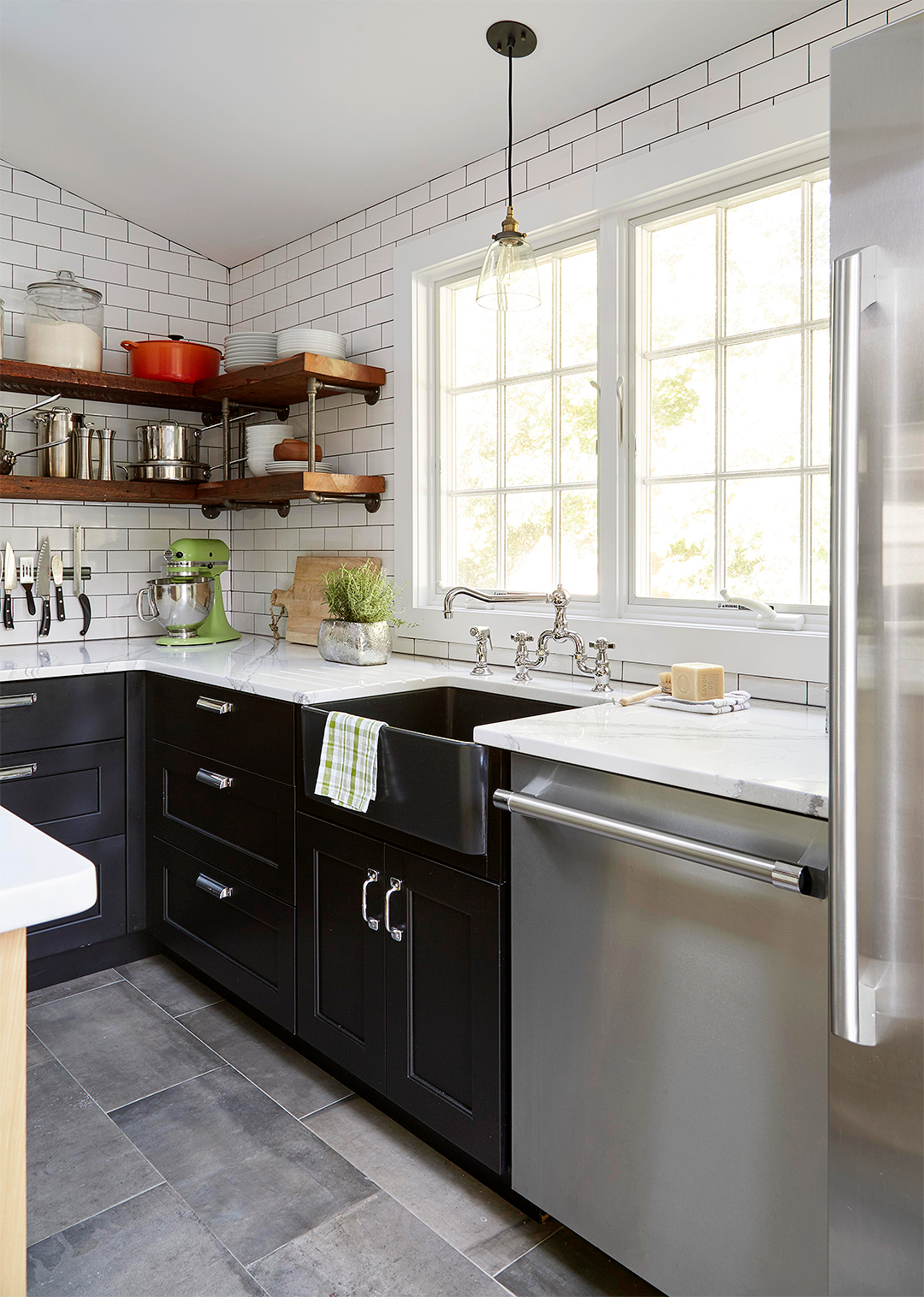 black and white industrial kitchen with apron sink