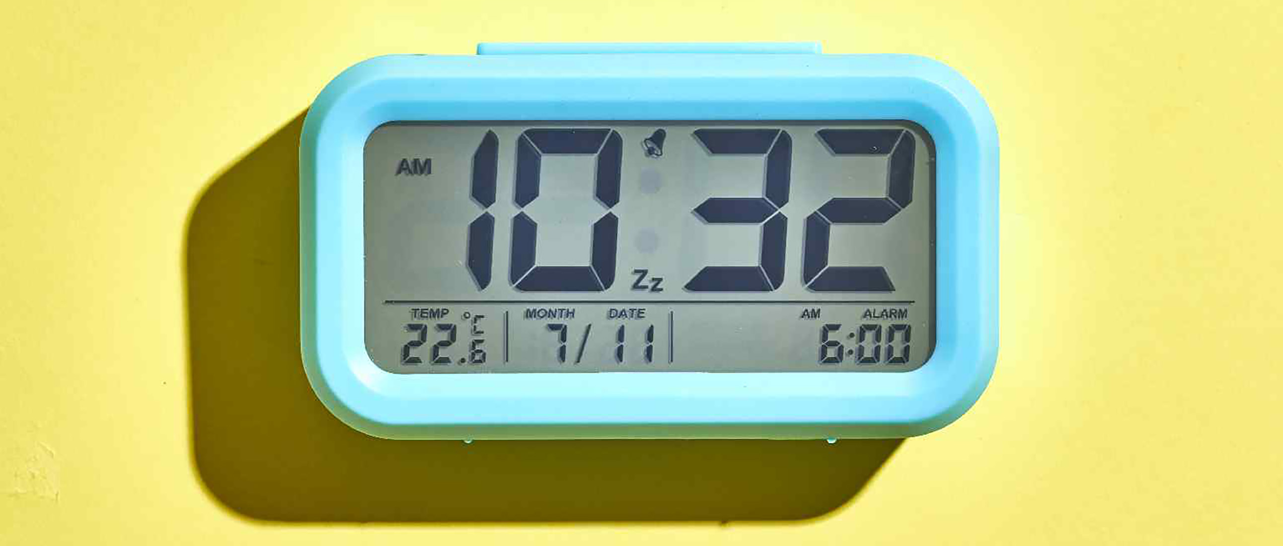 colorful alarm clock set to waking time