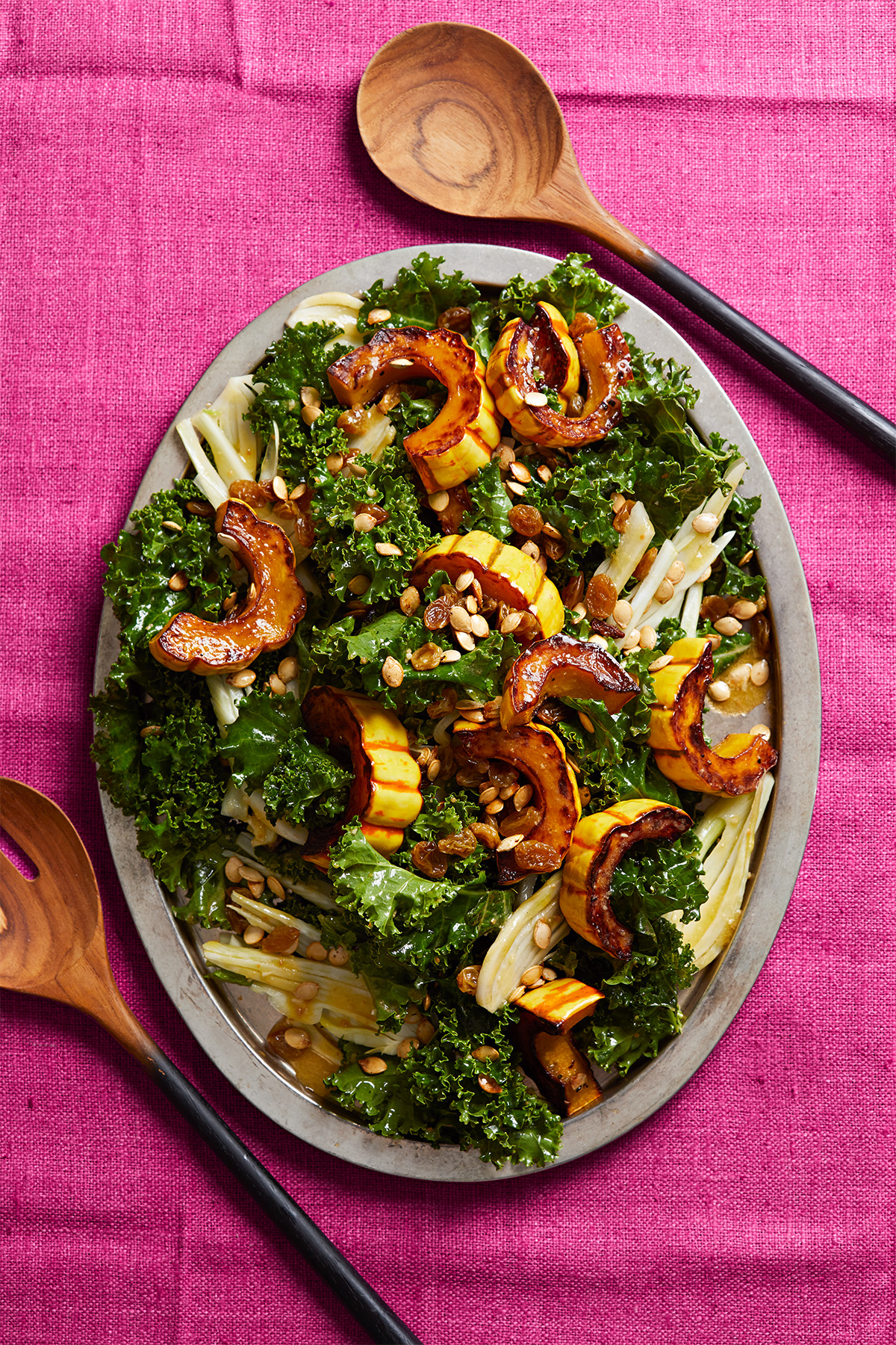 Kale, Fennel, and Roasted Delicata Salad on oval platter pink tablecloth