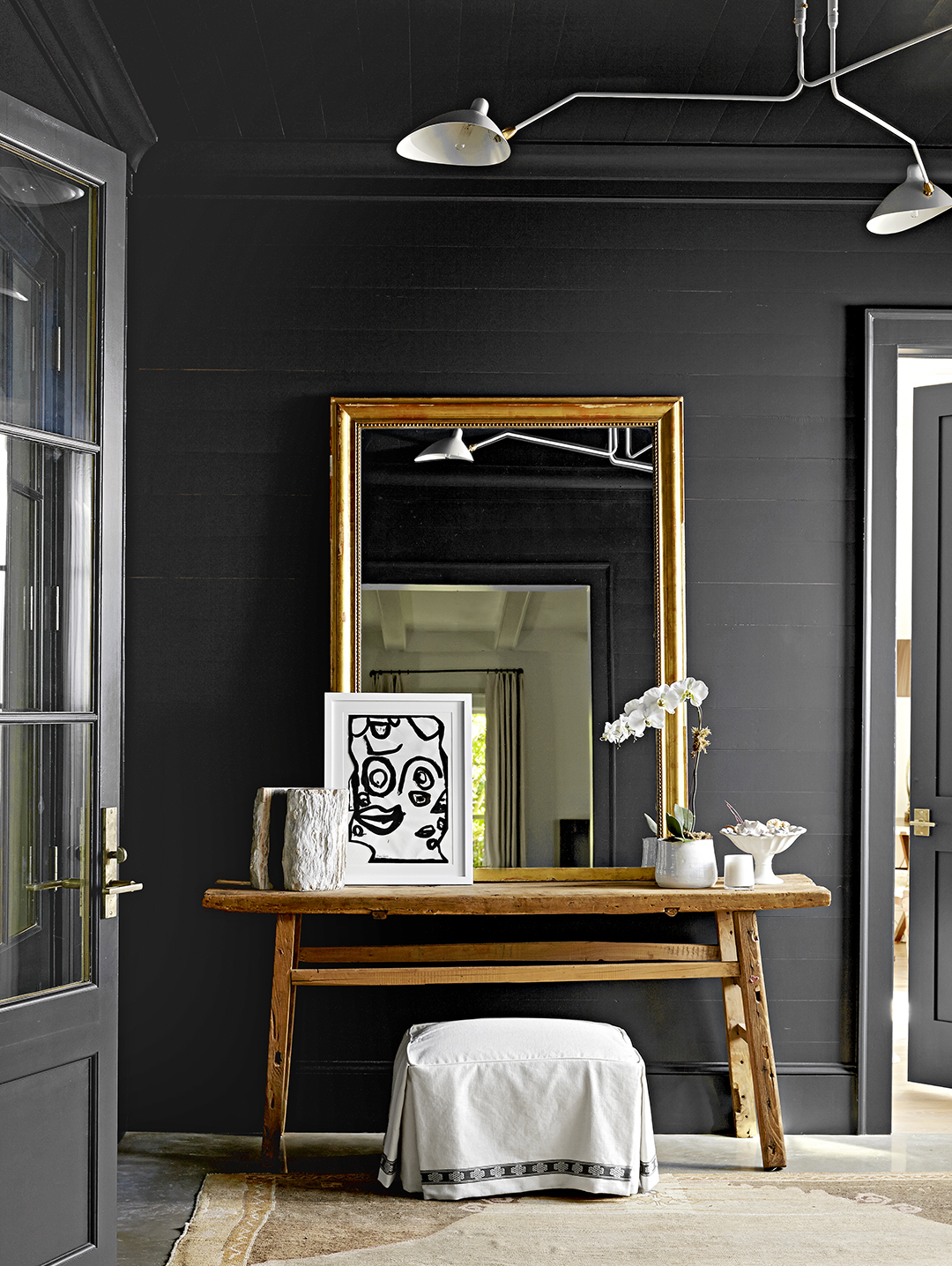 dramatic rustic table with mirror and art