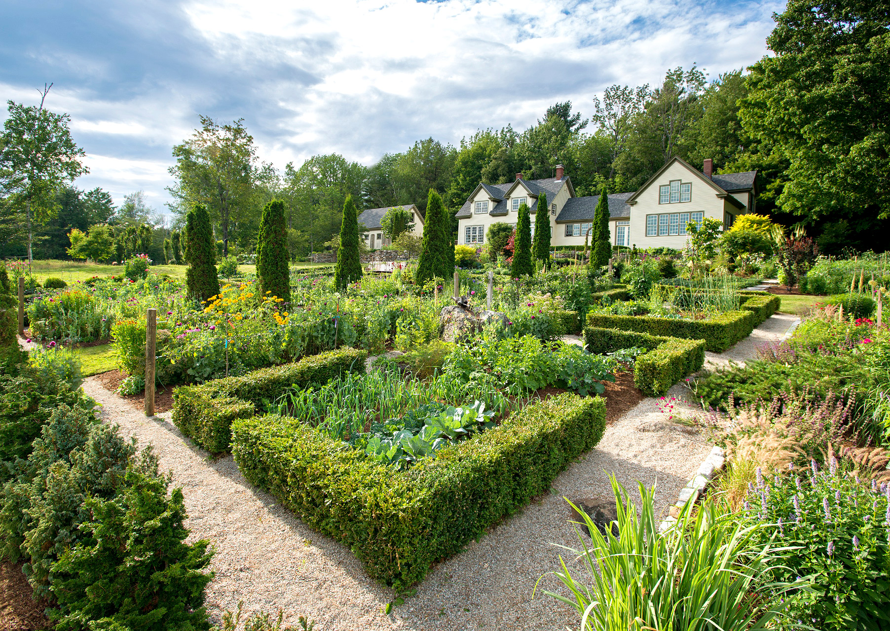 boxwood parterres with various planted vegetables