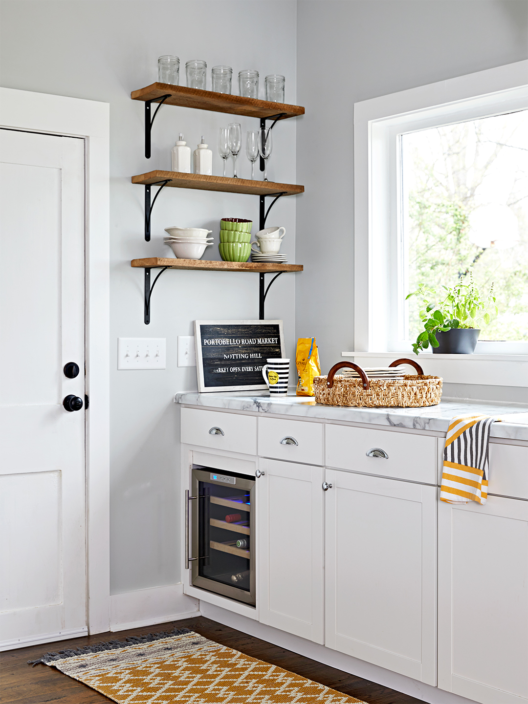 repurposed wood shelves for simple storage in grey kitchen