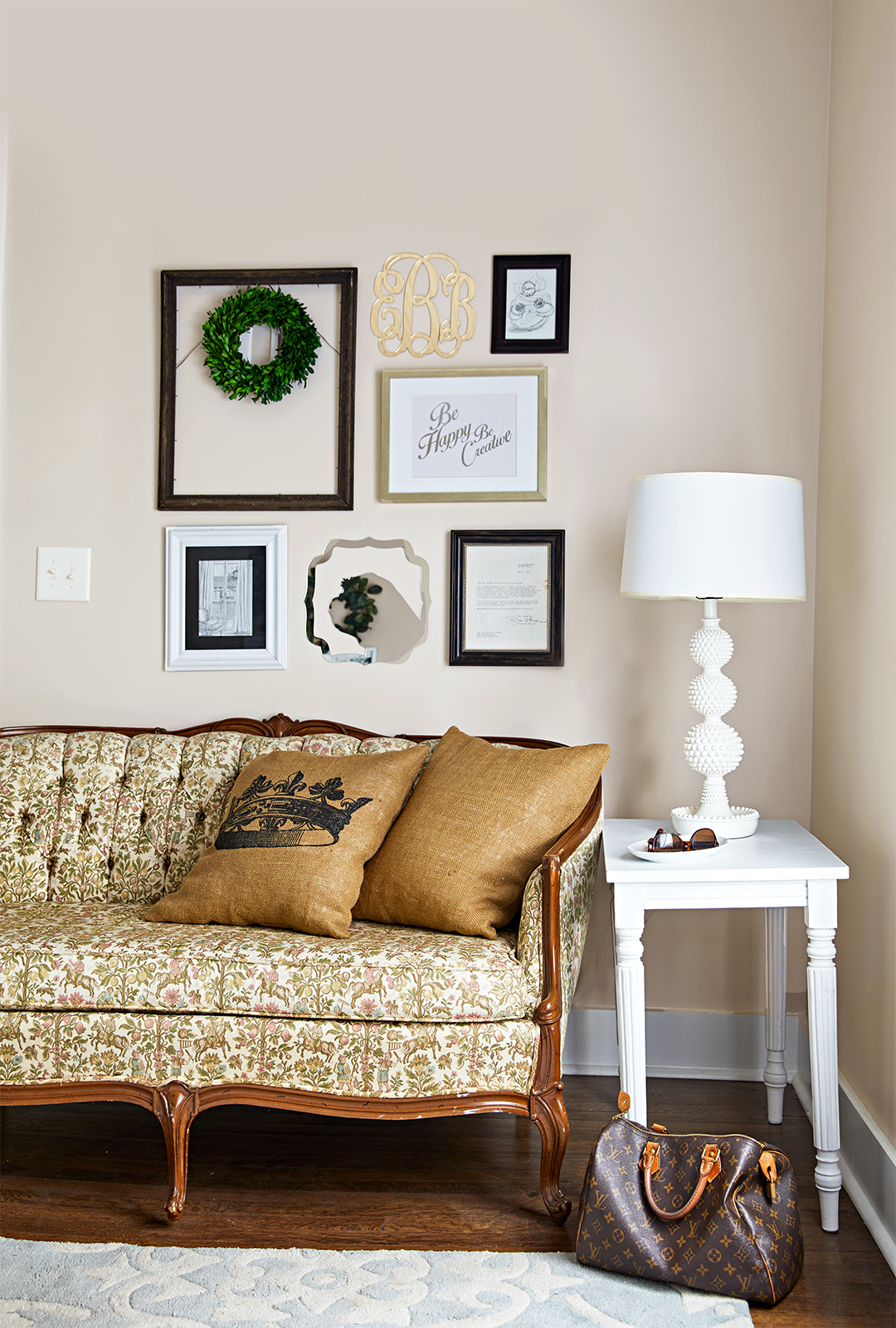 vintage sofa in home office with collection of personal art