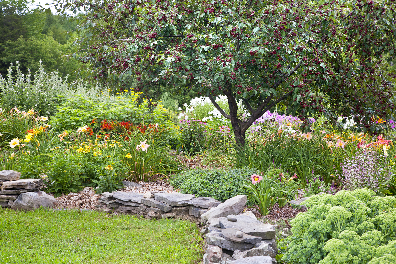 garden beds with stacked stone edging
