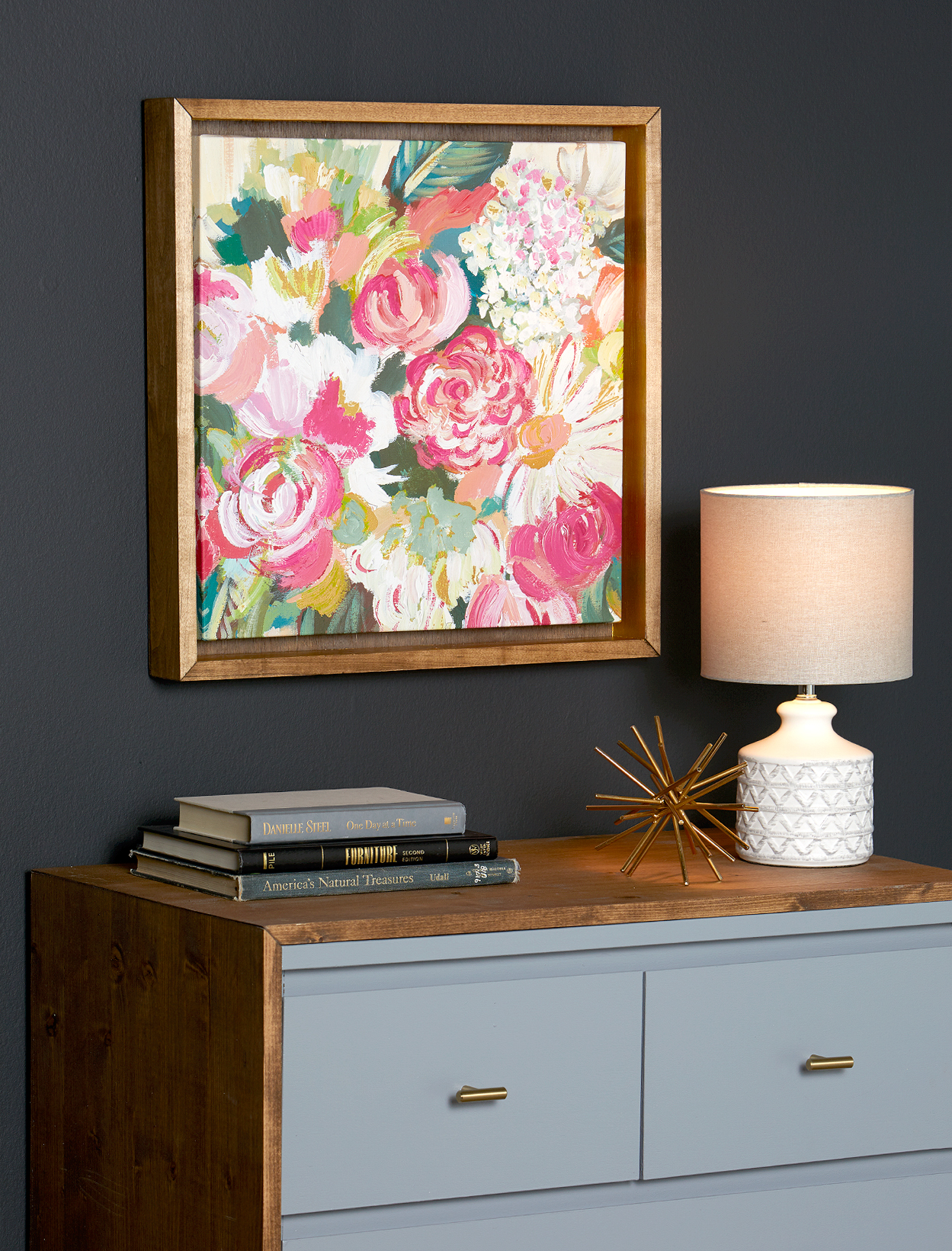 mounted floral canvas in frame above dresser wall art