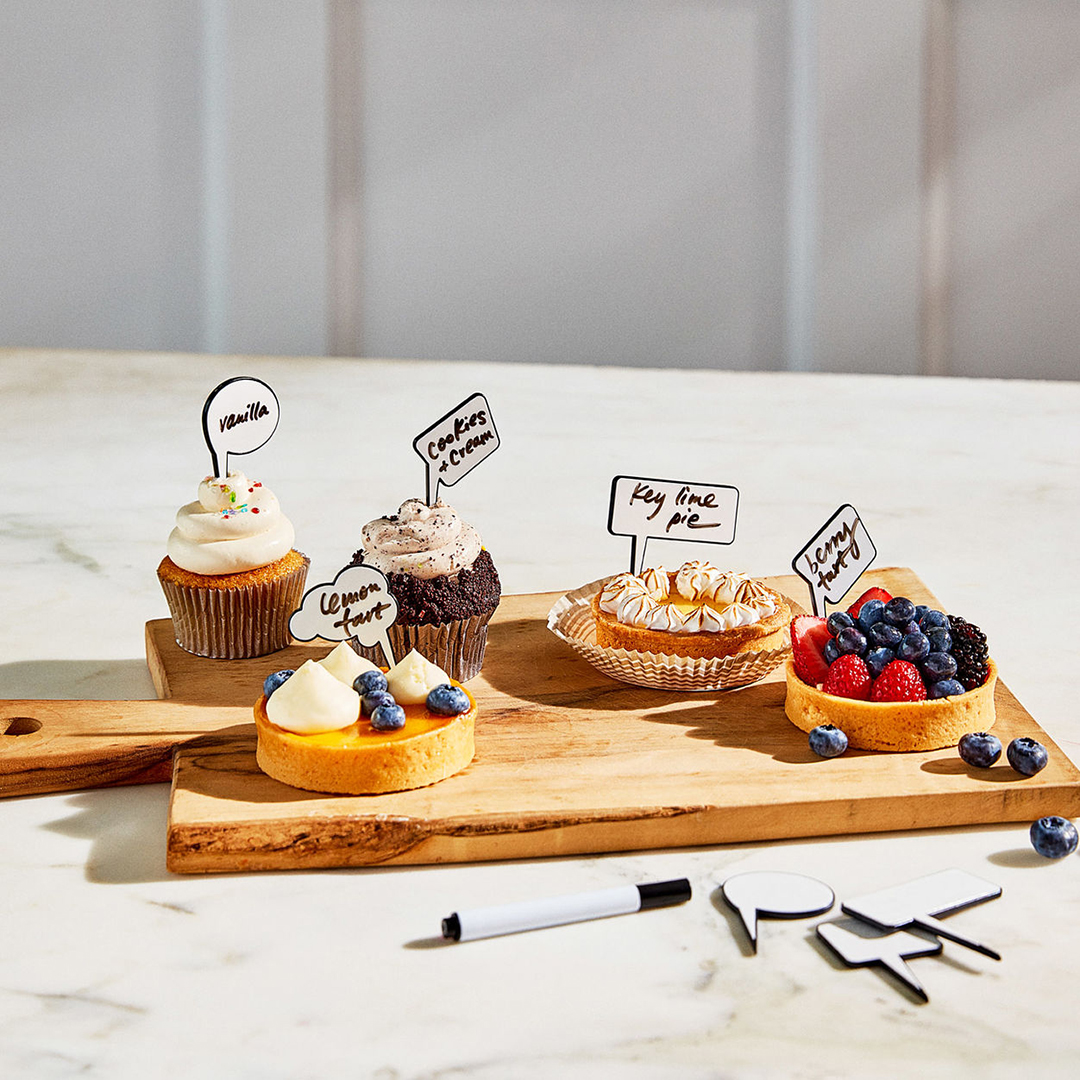 chit chat markers with pastries on cutting board