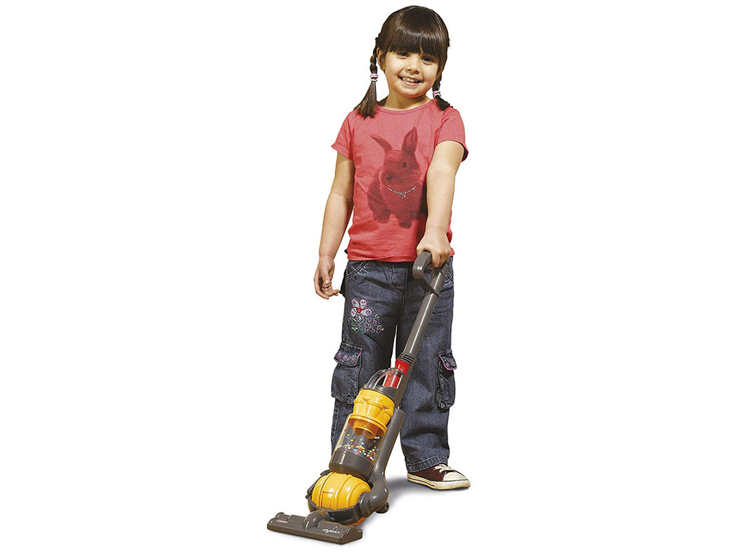 Girl with Dyson toy vacuum