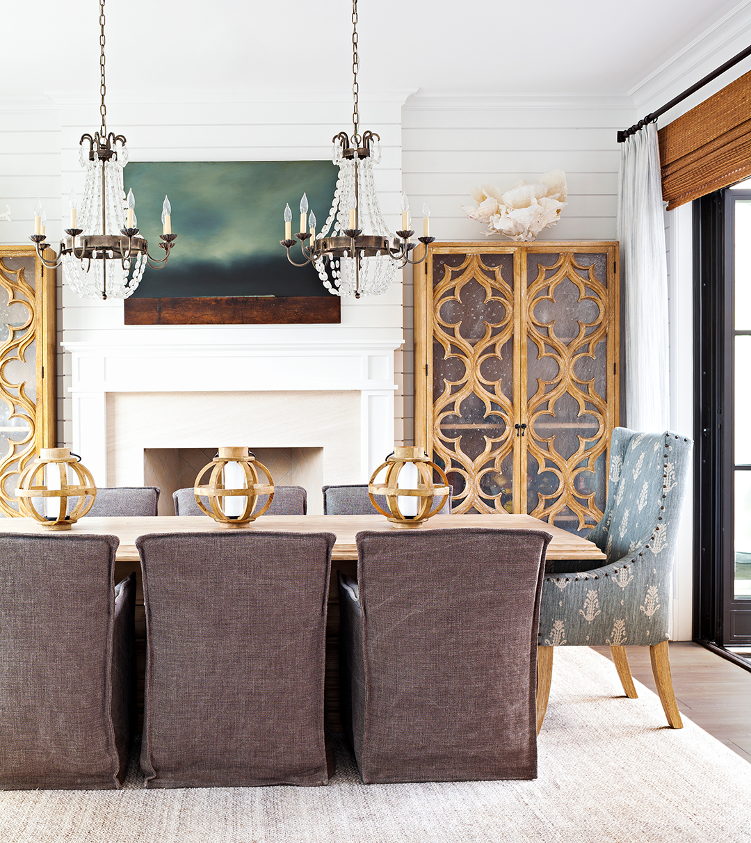 dining area with crystal chandeliers and fireplace