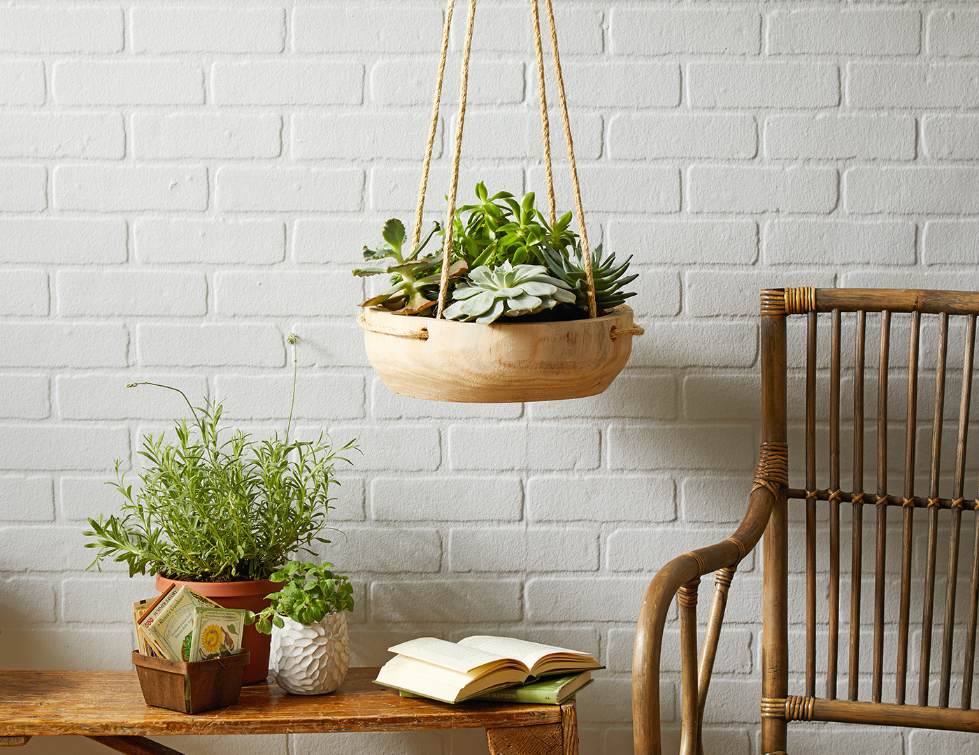 wooden handing planter with succulents