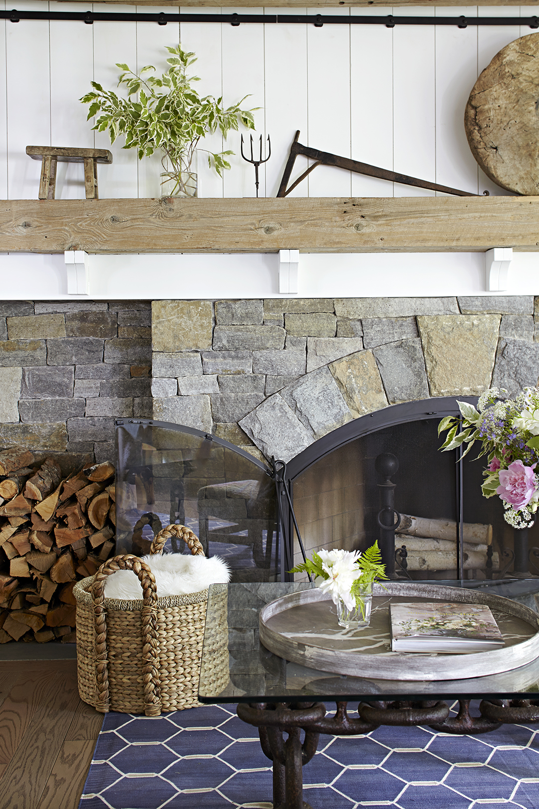 living room with stone fireplace in modern farmhouse