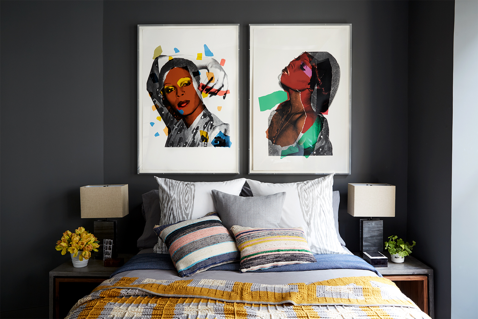 gray bedroom with gen z yellow accents and two graphic prints hanging above bed