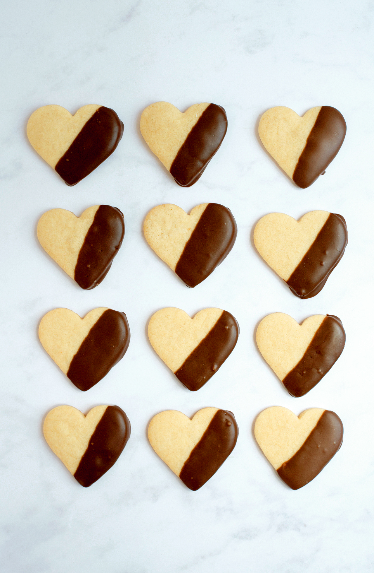 rows of chocolate-dipped heart-shaped cookies