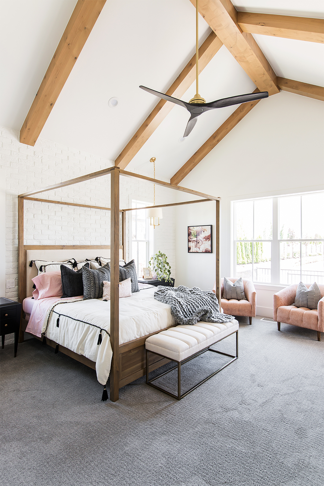 master bedroom with vaulted ceilings and 4 poster bed