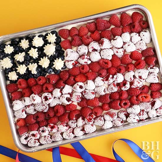 red white and blue flag cake with raspberries and blueberries