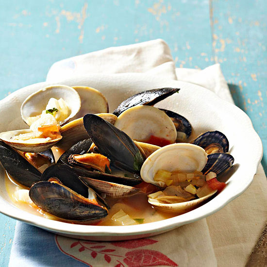 Garlicky Steamed Mussels and Littleneck Clams with Pesto Toasts