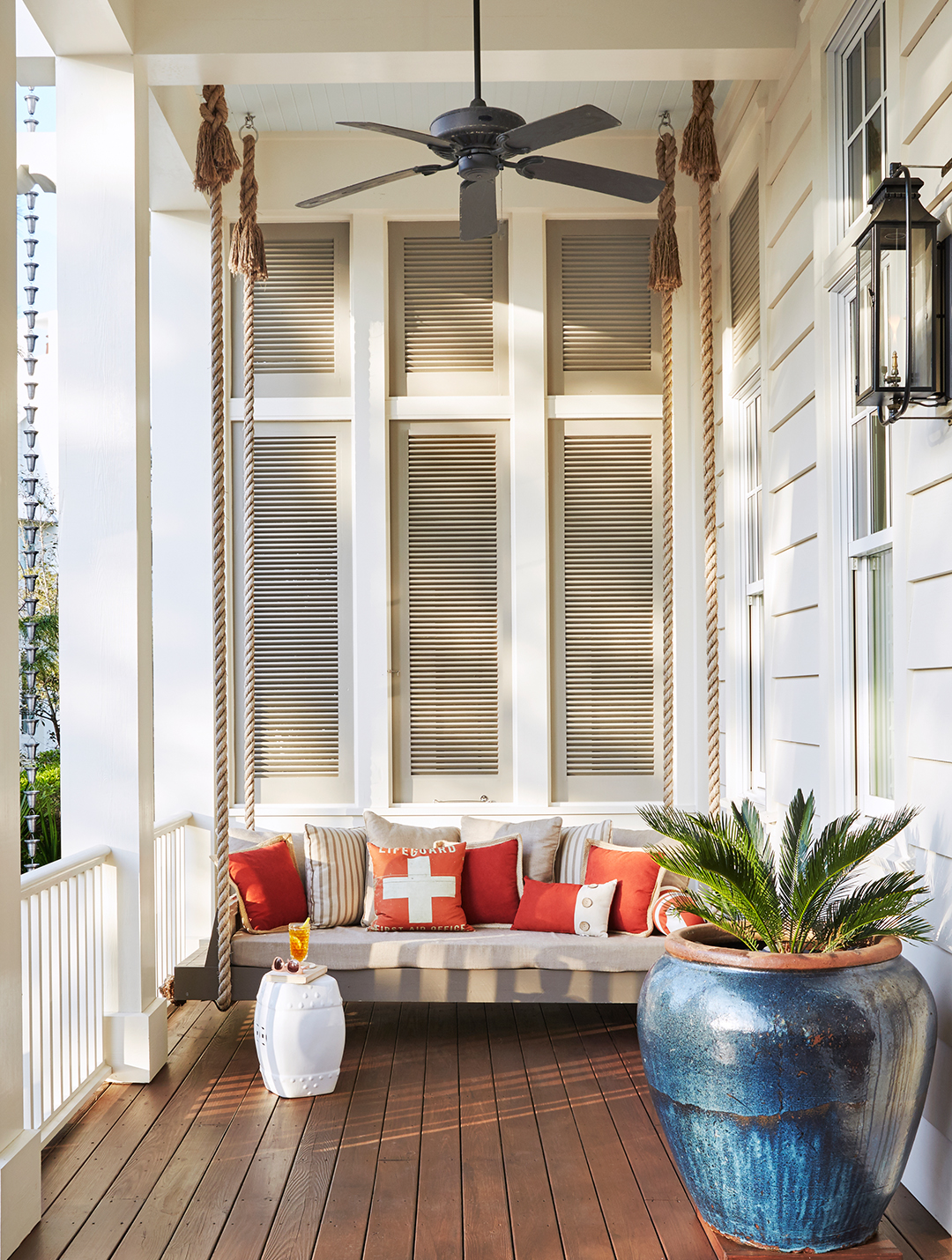 front porch with plant and large swing