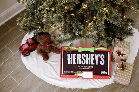 Giant Hershey's chocolate bar under a Christmas tree