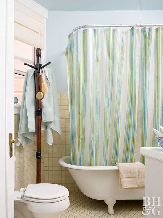 claw foot tub blue green bathroom